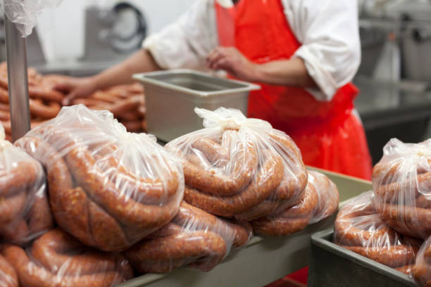 Sausage being made in a factory.